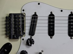 The bridge pickup is an original Seymour Duncan Hot Rails.  The neck and middle pickups are DiMarzio, of indeterminate type.