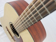 I love the look of this guitar because of the contrasting front color of the wood and the side and back darker color.